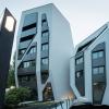 JMayerH设计的住宅和办公大楼具有单色外墙和假阴影